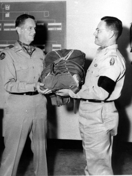 1st Change Of Command, 1957. LTC Madding Passes Parachute To COL Marshall Wallach. Group Did Not Have Colors Yet